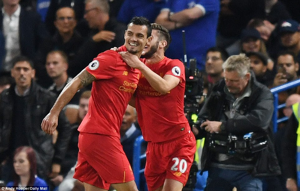 Lallana races to celebrate with his Liverpool team-mate Lovren, who was still sporting his black eye