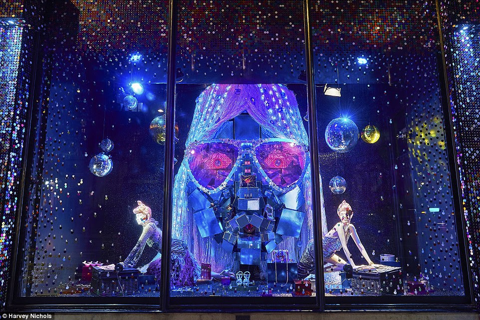 The disco glam theme with hand-strung sequins is in stark contrast to last year's  enchanted forest theme at the store, which saw windows filled with whimsical scenes depicting magical fairytales