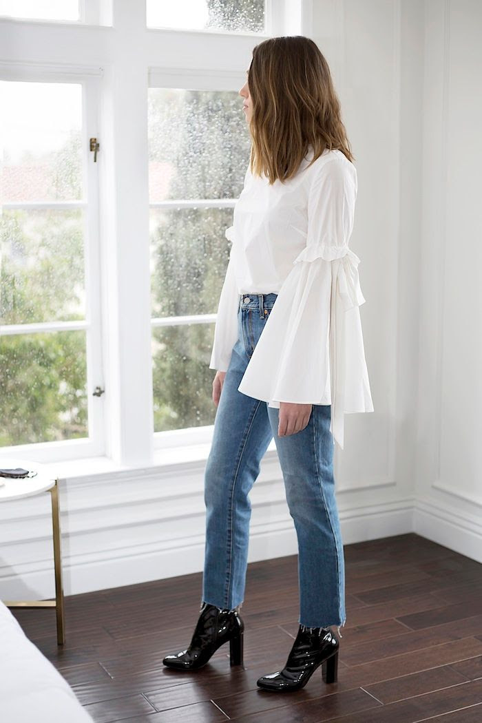 1 Biggest Winter Trends White Statement Sleeve Top Levis Jeans Black Ankle Boots Long Wavy Bob Hairstyle Erin Pederson Nicole Carbone Le Fashion Blog