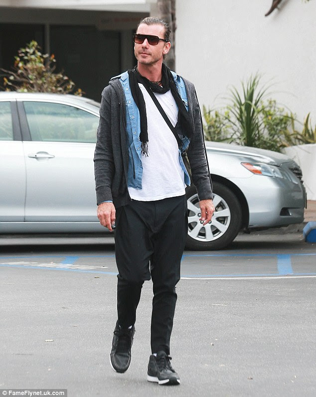 Rock star: Gavin had nearly matching low-crotch black trousers, a white t-shirt covered with a pale blue shirt