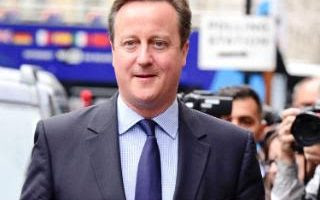 David Cameron pictured today on his way to vote