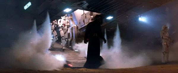 Kylo Ren (Adam Driver) is flanked by First Order Stormtroopers as they disembark from his shuttle upon arrival at Jakku in STAR WARS: THE FORCE AWAKENS.