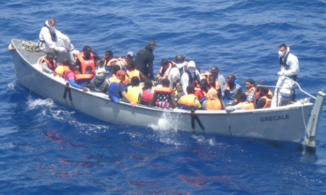 A lifeboat from the Italian frigate Grecale carries a group of migrants rescued in the Mediterranean Sea en routeto the port at Pozzallo, on the southern tip of Sicily.