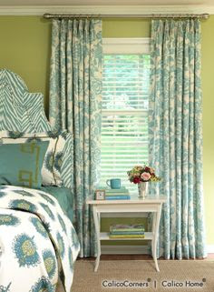 Cosmopolitan Fabric Collection - fan-pleated draperies in Aviary fabric, color Robin. Julia headboard & pleated bed skirt in Zebra Skin Outdoor fabric, color Aquamarine; custom-fitted coverlet & Euro shams in Montego fabric, color Peacock; Banquito bench in Manlius fabric, color Teal; custom flanged shams in Westminister fabric, color Aqua/Green.