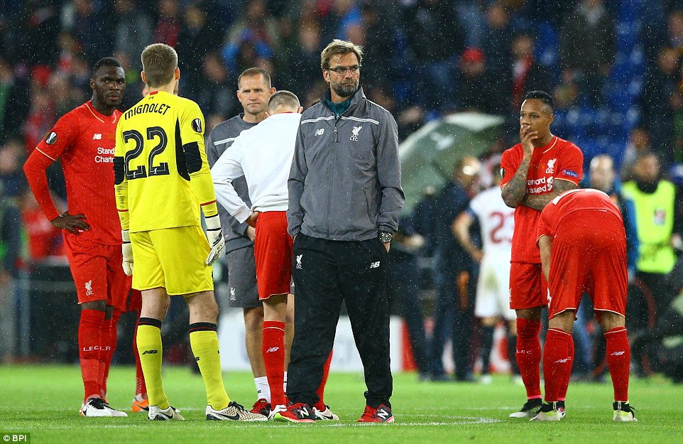 Liverpool coach Jurgen Klopp (centre) tries to console his players after losing a fifth consecutive cup final as a manager