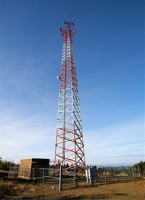 A cell phone cite on a self support tower in O...