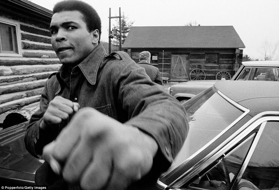 Ali pretends to punch the camera  while in training for a second fight with Joe Frazier in 1974; he won by unanimous decision in New York