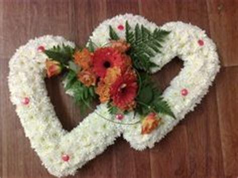 Funeral Arrangement Horseshoe   flower arrangements by