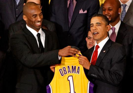 Los Angeles Lakers guard Kobe Bryant (left) presented a jersey to President Obama during an event with the National Basketball Association's 2009 champions at the White House.