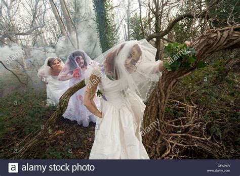 three young women dressed as brides taking part in a