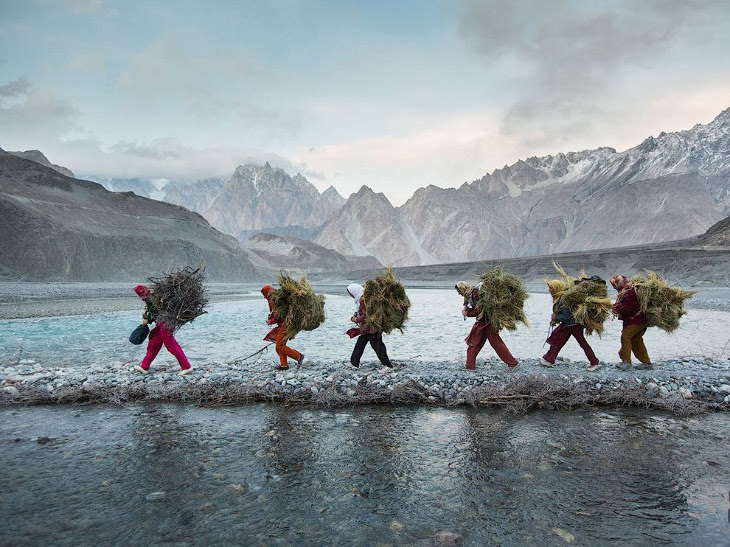 Women returning home with firewood and fodder, Pakistan