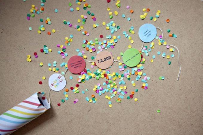 Pop Up Kertas, ketika tutup nya dibuka maka akan ada ledakan kecil berisikan potongan kertas kecil-kecil dan kertas besar berisikan info pernikahan.