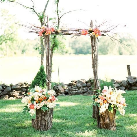 Simple ceremony arch made of tree branches and fresh