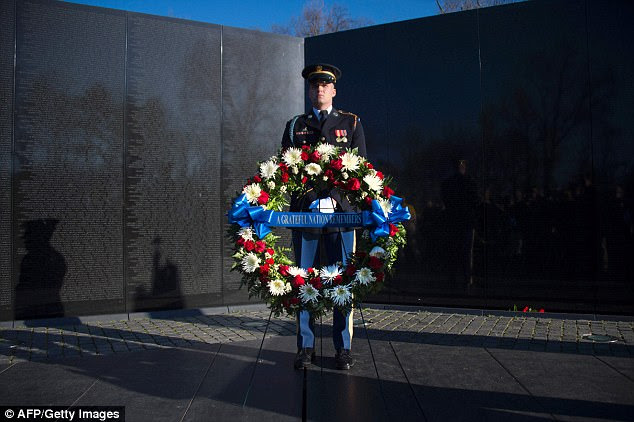 The American people, already sceptical about the war, were traumatised by the revelation of the Communists¿ capability to wreak wholesale death and destruction. Pictured: a wreath laying ceremony at the Vietnam Veterans Memorial in Washington, DC, in 2016