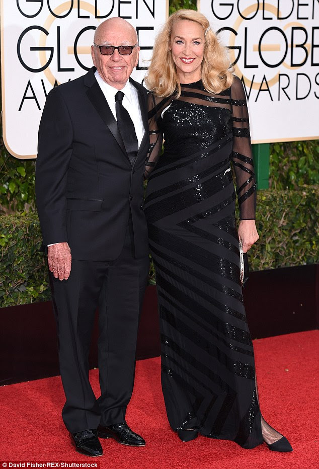 Whirlwind romance: Media mogul Rupert Murdoch, 84, and former supermodel Jerry Hall, 59, posed arm-in-arm on the red carpet of the Golden Globe Awards on Sunday night. Mr Murdoch proposed over the weekend