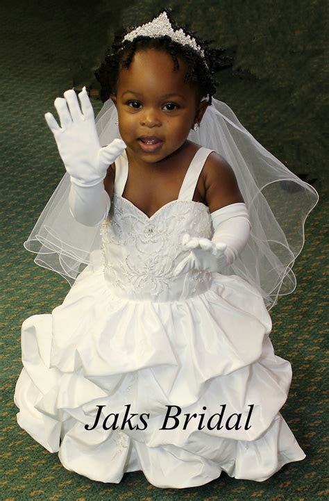 Toddler wedding dress with pickup skirt.