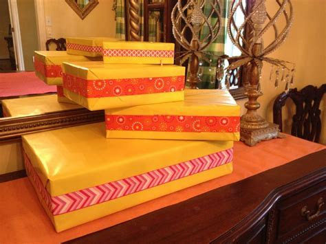 My cupcake stand! Cardboard boxes, wrapping paper, and a