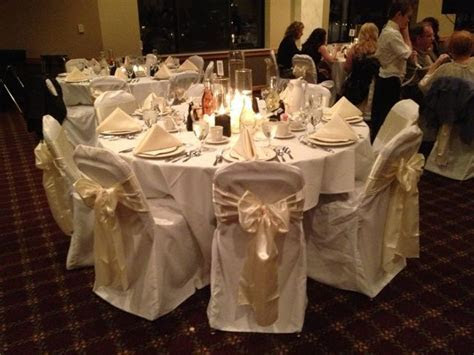 White chair covers with ivory chair sashes   Wedding