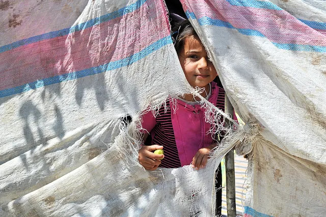 Syrian refugee girl. Credit: thomas koch via Shutterstock.