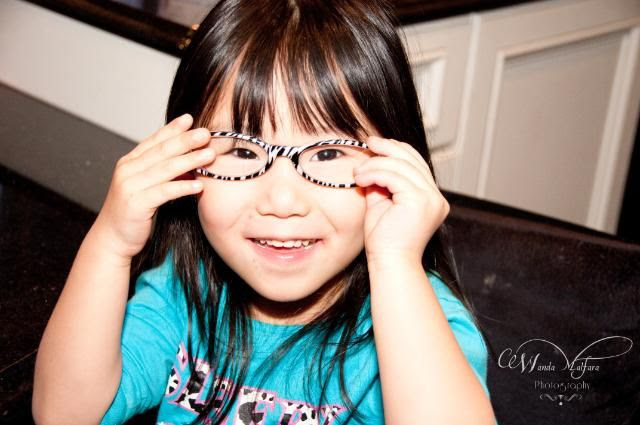 Tues March 20, 2012, My monkey, Milana, playing with Mommy's glasses.