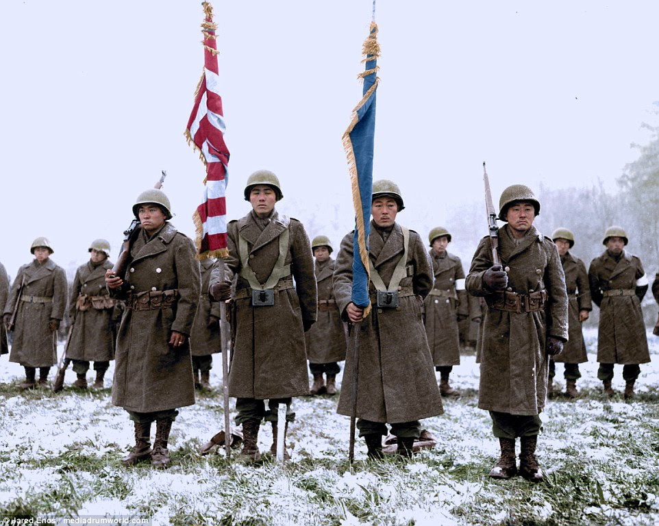 Two color guards and color bearers of the Japanese-American 442nd Combat Team, stand to attention in the Bruyeres area, France, on November 12 1944.  The regiment was a fighting unit composed almost entirely of American soldiers of Japanese ancestry. In total around 14,000 Japanese-Americans fought in World War II