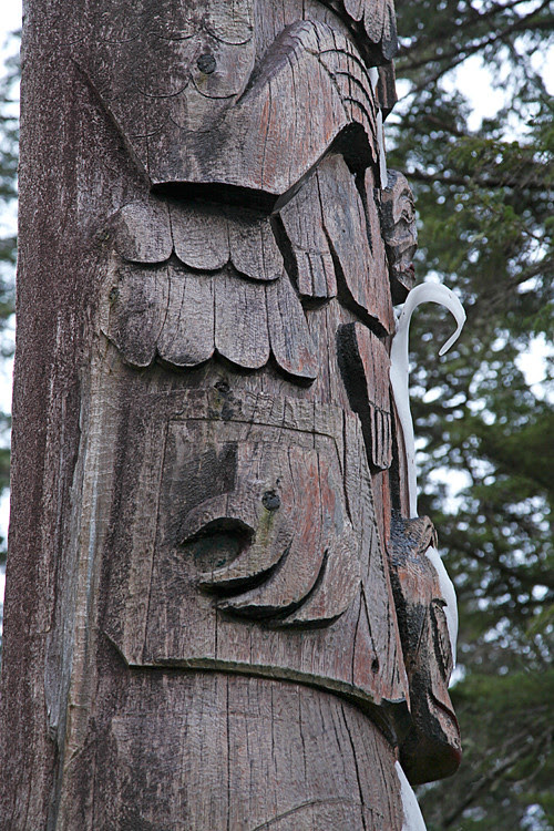 snow peels off totem like paint, Kasaan, Alaska