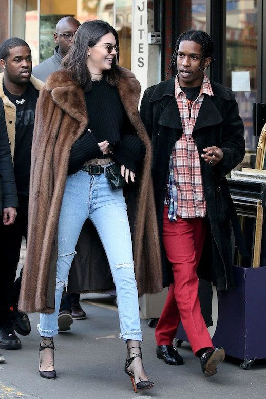 Le Fashion Blog Kendall Jenner Paris Style Cropped Jeans Fanny Pack Black Sweater Strappy Heels Brown Fur Coat Via Vogue