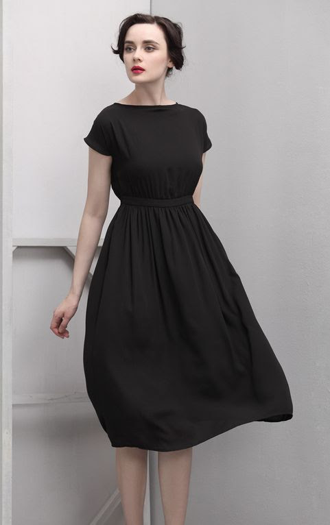 Perfect fit black dress. It kind of looks like something a woman in an institution would wear in the 50s, though,