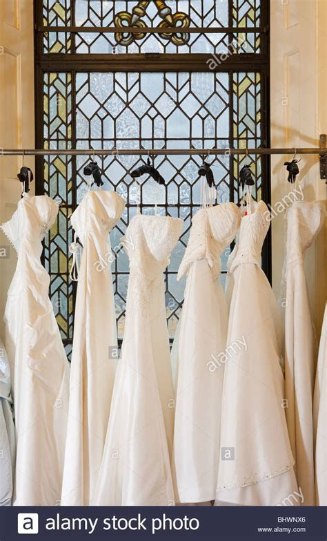 A row of Wedding Dresses hanging on a clothes rail Stock