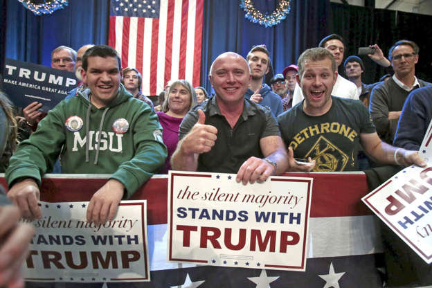 Trump supporters listen as U.S. Republican presidential candidate Donald Trump speaks during a campaign rally in Grand Rapids, Michigan December 21, 2015.