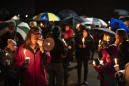 The Latest: Hundreds gather for vigil for Girl Scouts killed