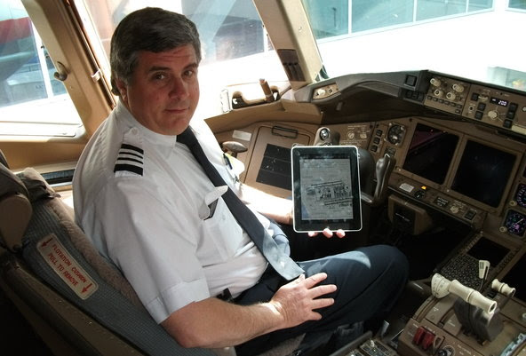IPads may have made their way into cockpits, but passengers have been barred from using them while the plane is taxiing, taking off or landing -- a rule that federal regulators are taking a new look at.