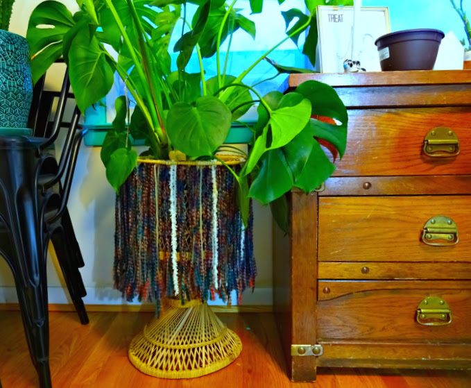 vintage wicker planter boho-ified with yarn fringe skirt