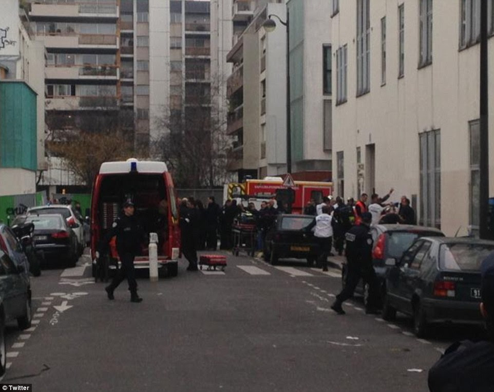 Benoit Bringer, a journalist with Agence Premiere Ligne, told the iTele network he saw several masked men armed with machine guns