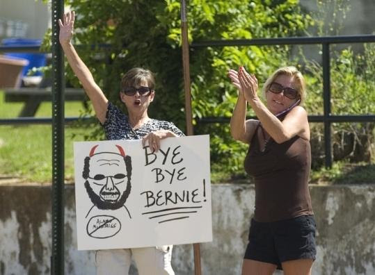 Sandy Buchanan (left) and Dana Richardson waved to the bus carrying the jury yesterday after evangelist Tony Alamo's conviction on 10 accounts of sex abuse in Texarkana, Ark.