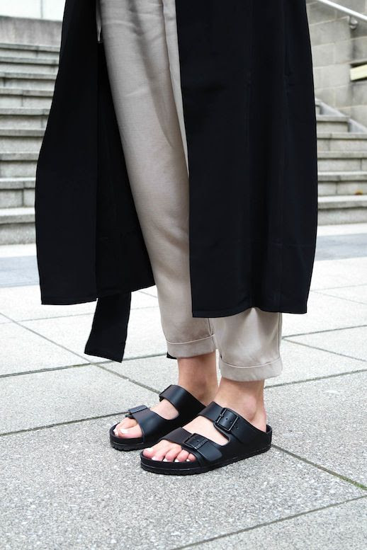 Le Fashion Blog Black Long Trench Coat High Waisted Cuffed Crop Pants All Black Birkenstocks Via Brittany Bathgate