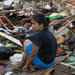 A woman sat amid debris in Tacloban on Wednesday, where conditions have not improved for residents suffering from lack of food and water.