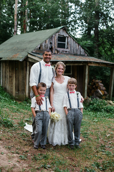 Bride, family, and bride and groom photos taken in the woods by the log cabin at Williams Tree farm in Rockton IL, Located about 20 minutes north of Rockford IL. The Wedding was a anniversary and vow renewal held for friends and family. They had many DIY and rustic country elements in their wedding and reception. Photo by Mindy Joy Photography