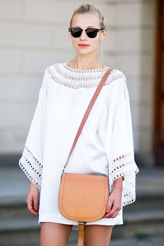 Le Fashion Blog Summer Street Style White Dress Eyelet Long Sleeves Tunic Clubmaster Sunglasses Chain Saddle Bag Via Vanessa Jackman photo Le-Fashion-Blog-Summer-Street-Style-White-Dress-Wide-Sleeves-Ray-Ban-Clubmaster-Sunglasses-Chain-Saddle-Bag-Via-Vanessa-Jackman.jpg