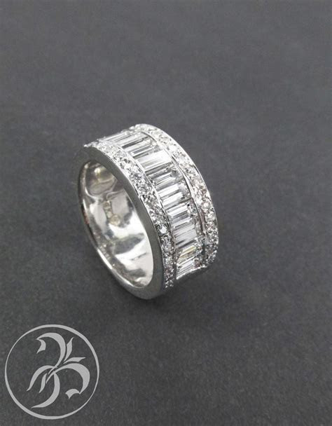 Baguette and round diamond chunky wedding band. Some