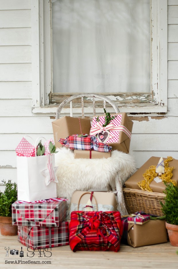 lovely wrapped christmas packages using fabric, ribbon and handmade elements