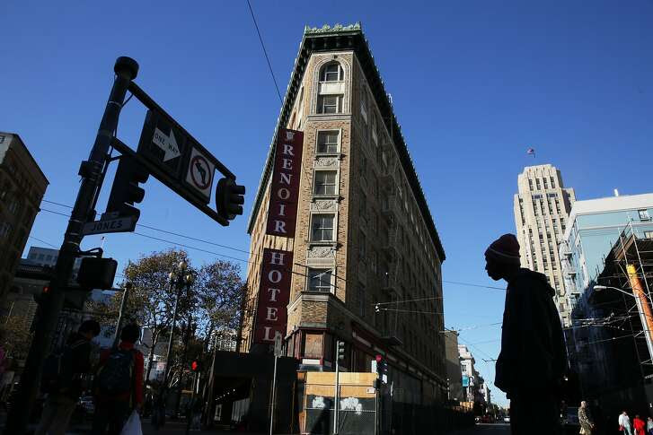 Pedestrians cross the street next to the Renoir Hotel on Thursday, October 29,  2015 in San Francisco, Calif.