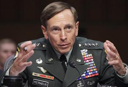 U.S. General David Petraeus gestures during the Senate Intelligence Committee hearing on his nomination to be director of the Central Intelligence Agency on Capitol Hill in Washington in this June 23, 2011, file photo. REUTERS-Yuri Gripas-Files