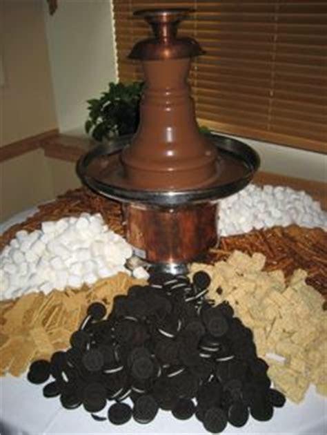 Chocolate fountain, fruit, veggies, bread, cheese and