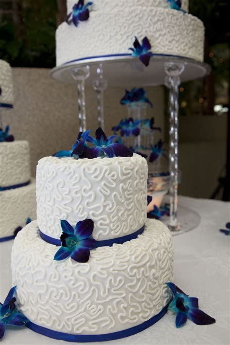royal blue wedding cake decorated with white chocolate