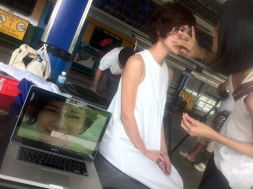 Fei Ling the producer doing make-up for Ley Teng 2