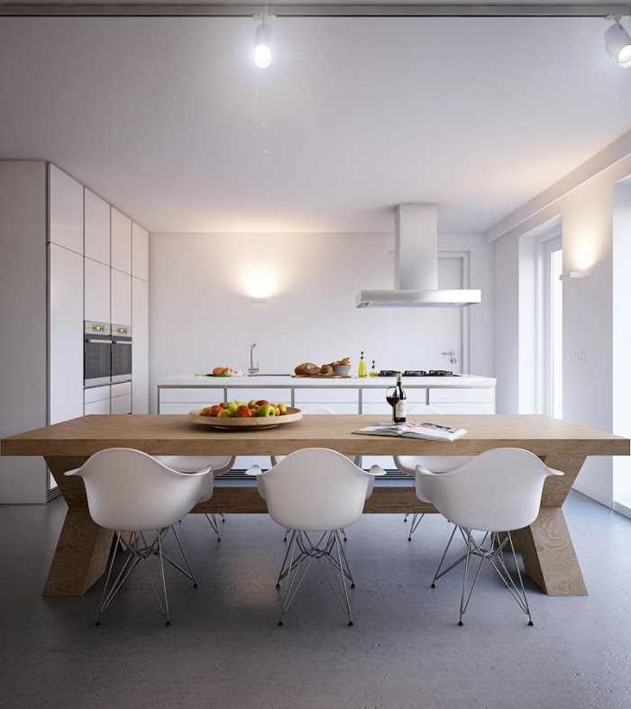 In the kitchen-diner a chunky wooden table adds another element of neutral warmth to the palette, but is flanked by modem white dining chairs so that the eating area remains in keeping with the rest of the culinary space.