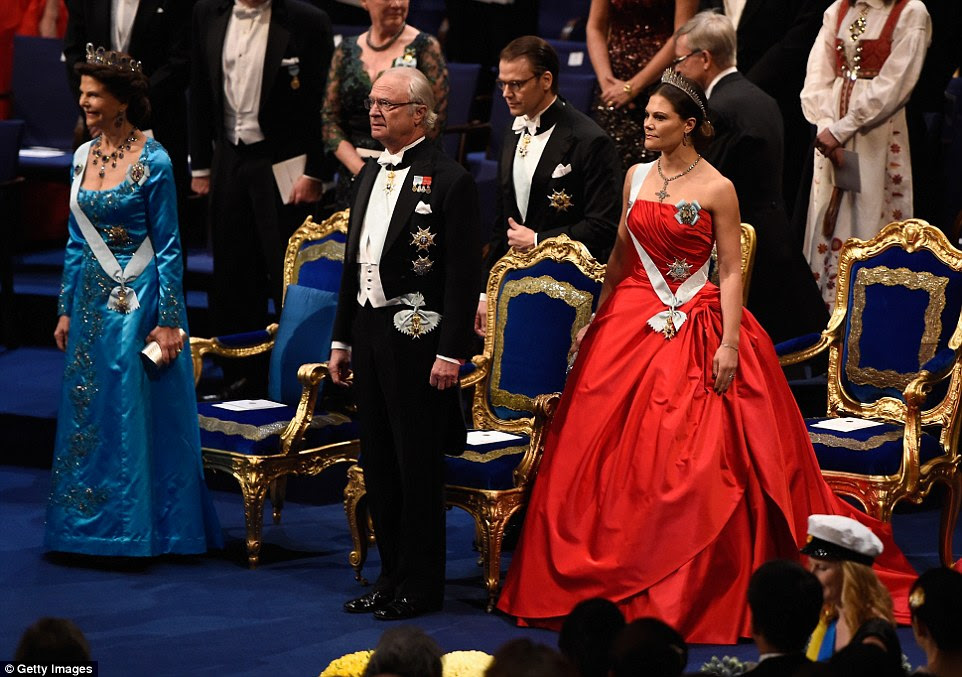The Swedish royal family stand during the ceremony. Pictured from left is Queen Silvia, King Carl XVI Gustaf and their daughter Crown Princess Victoria