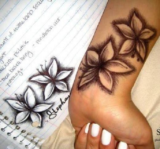 Orchid Tattoos On Left Wrist