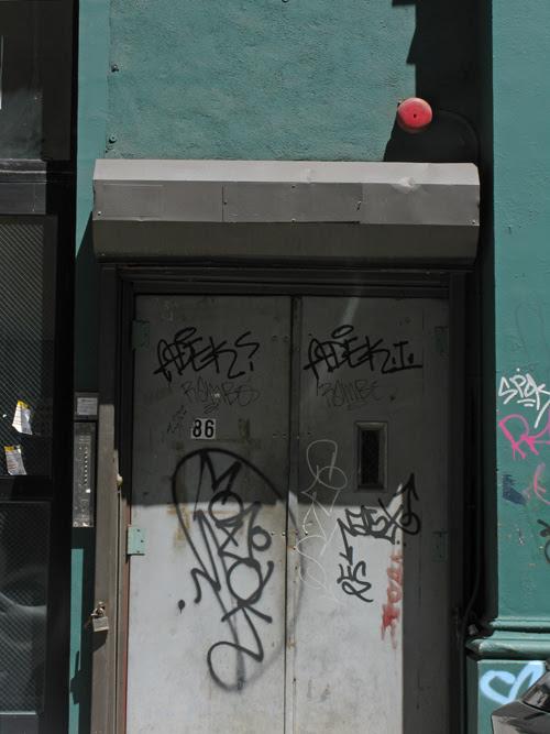 graffiti on TriBeCa entrance doors, Manhattan, NYC